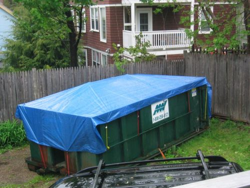 dumpster with tarp like tent
