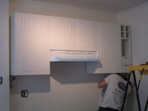 Kitchen cabinets hanging by a rail -- Adventures in Remuddling