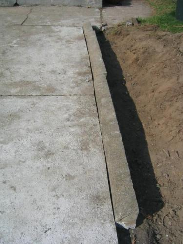 with concrete curb as edge